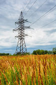High voltage line and thunderclouds — Stock Photo