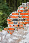 Old ruined red brick wall — Stock Photo