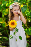 Young smiling girl with sunflower — Stock Photo