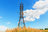 High voltage line and blue sky — Stock Photo