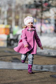 Young girl running at walkway — Stock Photo