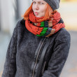 Portrait of beautiful red-haired young woman in hat and scarf — Stock Photo
