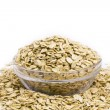 Oat flakes on a glass bowl — Stock Photo #12869065