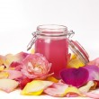 Aromatic rose water and petals — Stock Photo #21764853