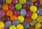 Colorful chewy dragees background — Stock Photo