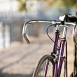 Road bicycle on city street — Stock Photo #13679783