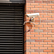Security camera on office building wall — Stock Photo