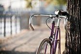 Road bicycle on city street — Stock Photo