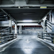 Parking garage in basement, underground interior, stop sign entr - Stock Photo