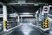 Parking garage in basement, underground interior, stop sign entr — Stock Photo