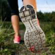 Woman and running shoes in forest, exercising in nature — Stock Photo #13914756