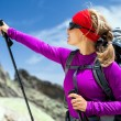 Stock Photo: Womhiking with backpack in mountains
