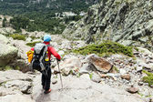 Woman hiking with backpack in Corsica mountains — Stock Photo