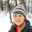 Woman hiking in winter forest — Stock Photo #14068253