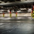 Stock Photo: Parking garage in basement, underground interior