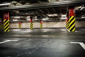Parking garage in basement, underground interior — Stock Photo