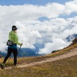 Stock Photo: Woman hiker walking in Himalaya Mountains, Nepal