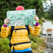 Woman hiking and reading map in forest — Stock Photo #15519167