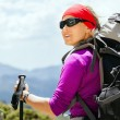 Woman hiking with backpack in mountains - Stock Photo