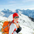 Hiking and walking woman in winter mountains — Stock Photo