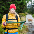Woman hiking and reading map in forest — Stock Photo #15520039