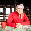 Woman hiker with map planning trip — Stock Photo #16283399
