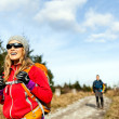 Couple walking and hiking on mountain trail — Stock Photo