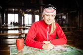Woman hiker with map planning trip — Stock Photo