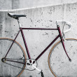 Stock Photo: City bicycle and concrete wall, vintage style