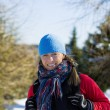Woman hiker walking in winter mountains — Stock Photo