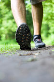 Walking or running on trail in summer forest — Stock Photo