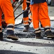 Road construction, teamwork — Stock Photo