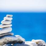 Stones balance, pebbles stack over blue sea in Croatia. — Stock Photo