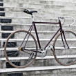 City bicycle and concrete stairs, vintage style — Stock Photo