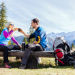 Stock Photo: Couple hikers camping and drinking in mountains