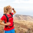 Young woman runner on trail in mountains — Stock Photo #26461207