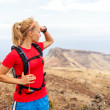 Young womrunner on trail in mountains — Stock Photo #26461207