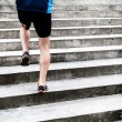 Постер, плакат: Man running on stairs sports training