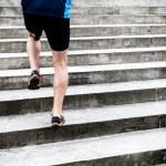 Man running on stairs, sports training — Stock Photo