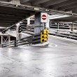 Parking garage interior and cars — Stock Photo