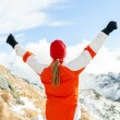 Hiking success, woman in winter mountains — Stock Photo