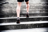 Jogger running on stairs, sports training — Stock Photo