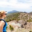 Hiking woman, runner in summer mountains — Stock Photo