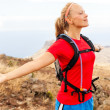 Young womrunner in mountains — Stock Photo #27517719