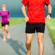 Couple running on country road — Stock Photo