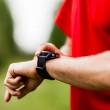 Runner looking at sports watch — Stock Photo #29995605