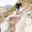 Woman trail running in mountains — Stock Photo