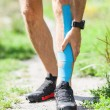 Stock Photo: Mrunning with kinesiotape