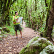 Hiker with map in forest — Stock Photo #29995709