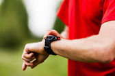 Runner looking at sports watch — Stock Photo